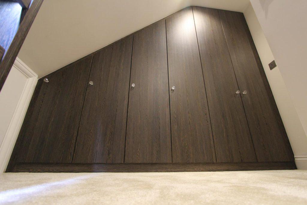 Ground level view of loft space wardrobe, N21