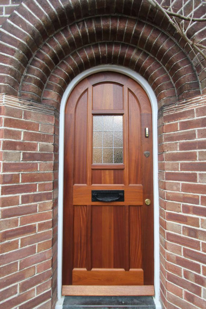 Arched sapele traditional front door, Winchmore Hill N21