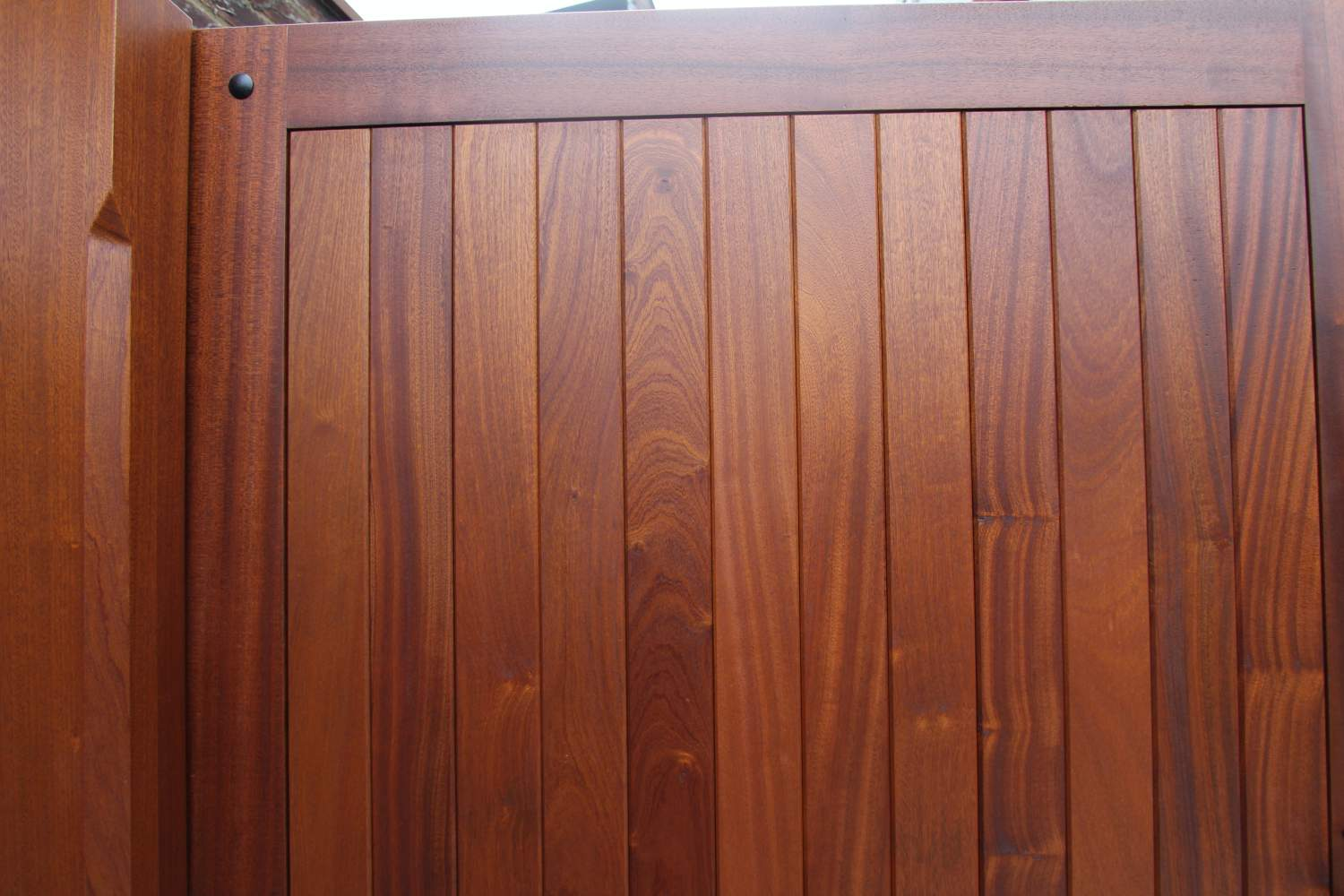 Close up of Sapele hardwood gates with Sikkens finish, Whichmore Hill N21