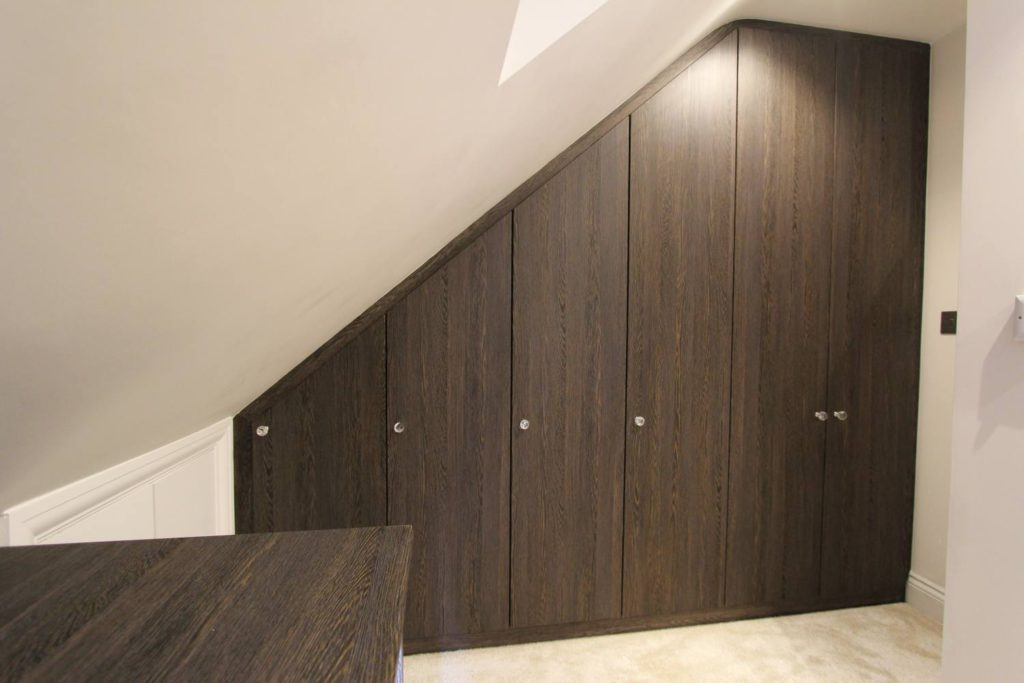Contemporary sloping roof fitted wardrobe, Winchmore Hill N21