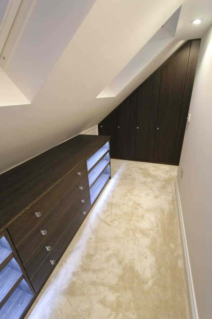 Illuminated drawer and shelving unit with slab style sloping wardrobe, Winchmore Hill N21