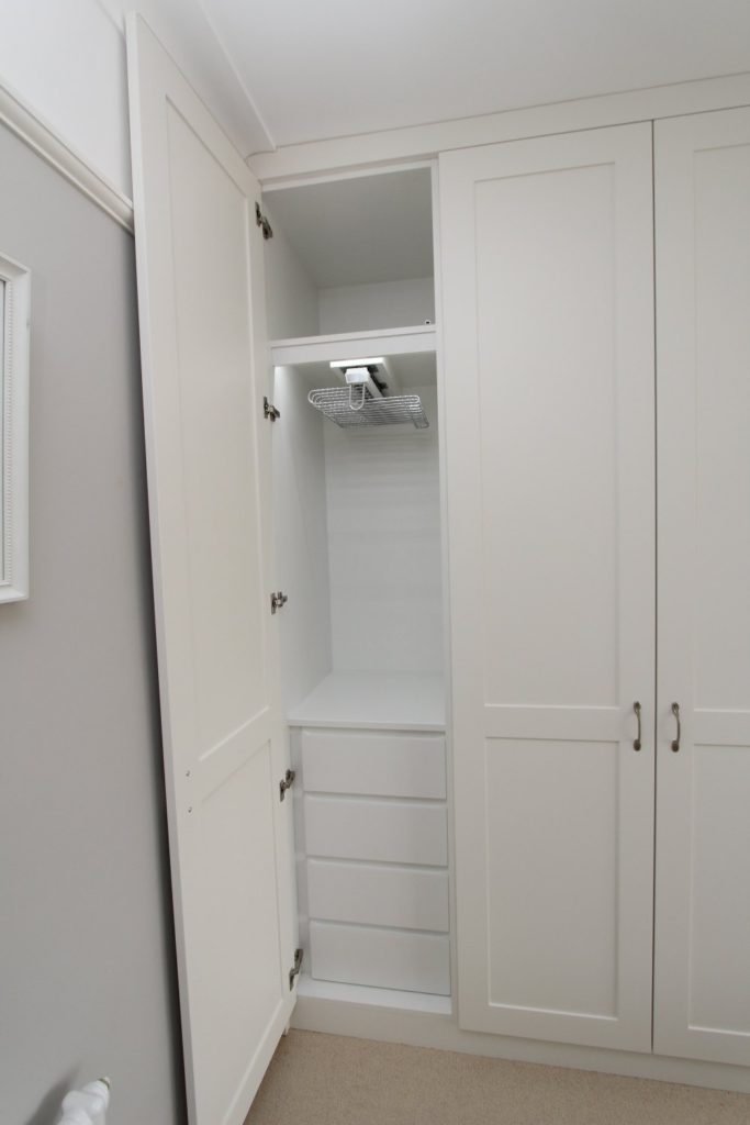 Bespoke shaker wardrobe with drawers, LED lighting and pull out trouser rail, Enfield EN2