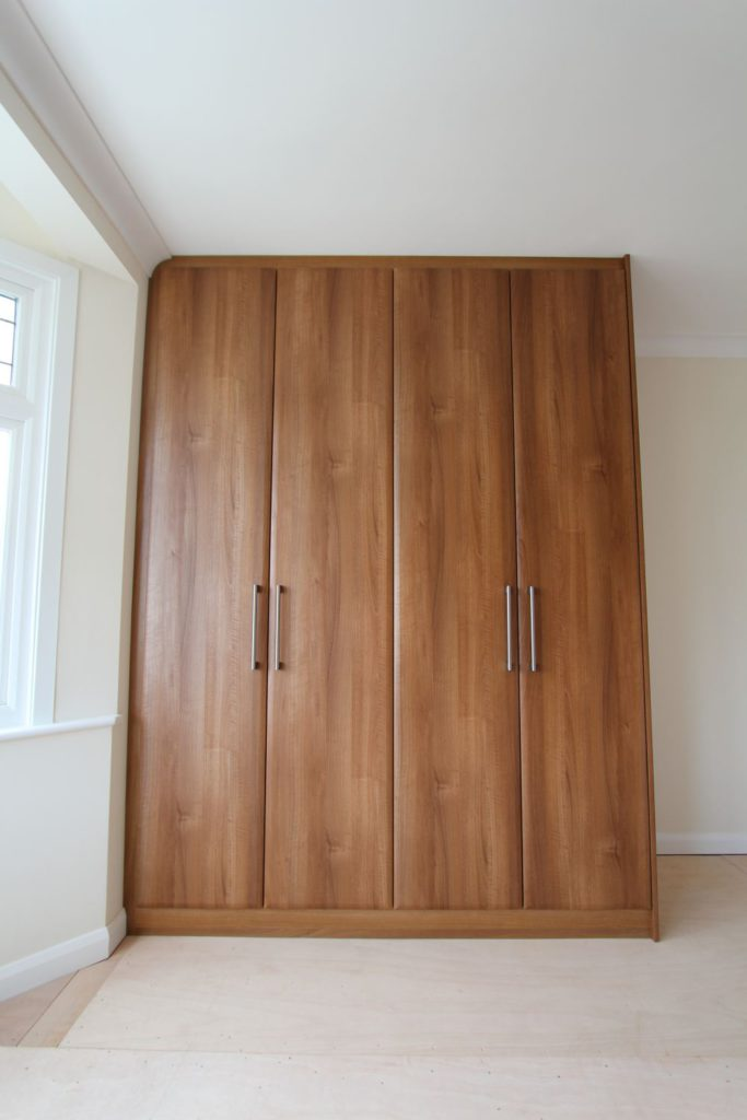 Made to measure walnut wardrobe, Winchmore Hill, N21