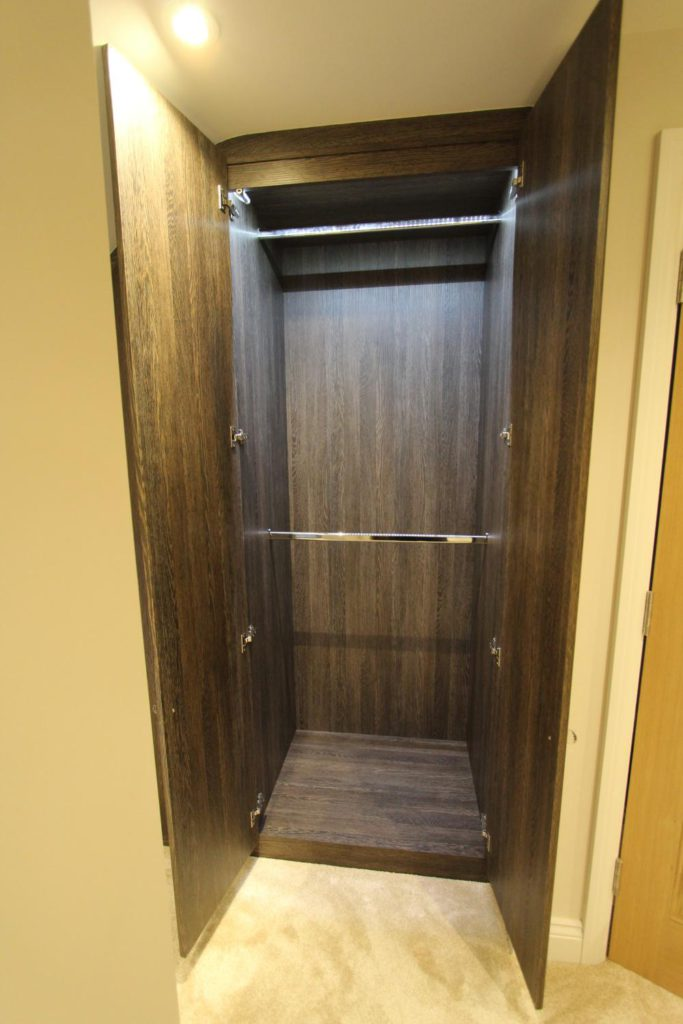 Double wardrobe interior with illuminated hanging space, Winchmore Hill N21
