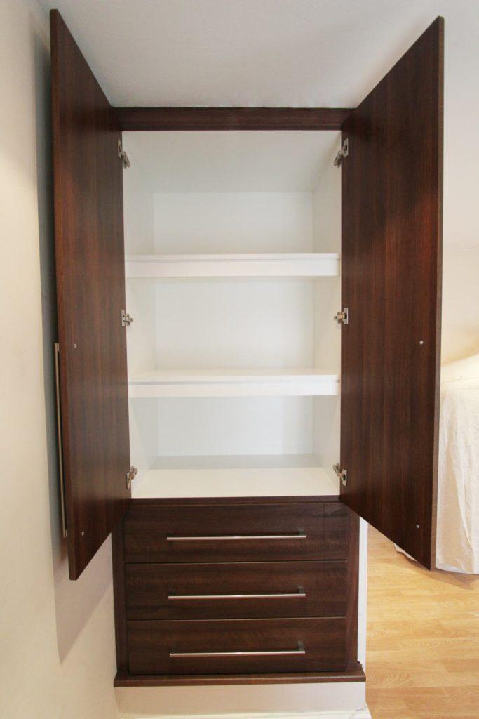Matt white alcove wardrobe interior
