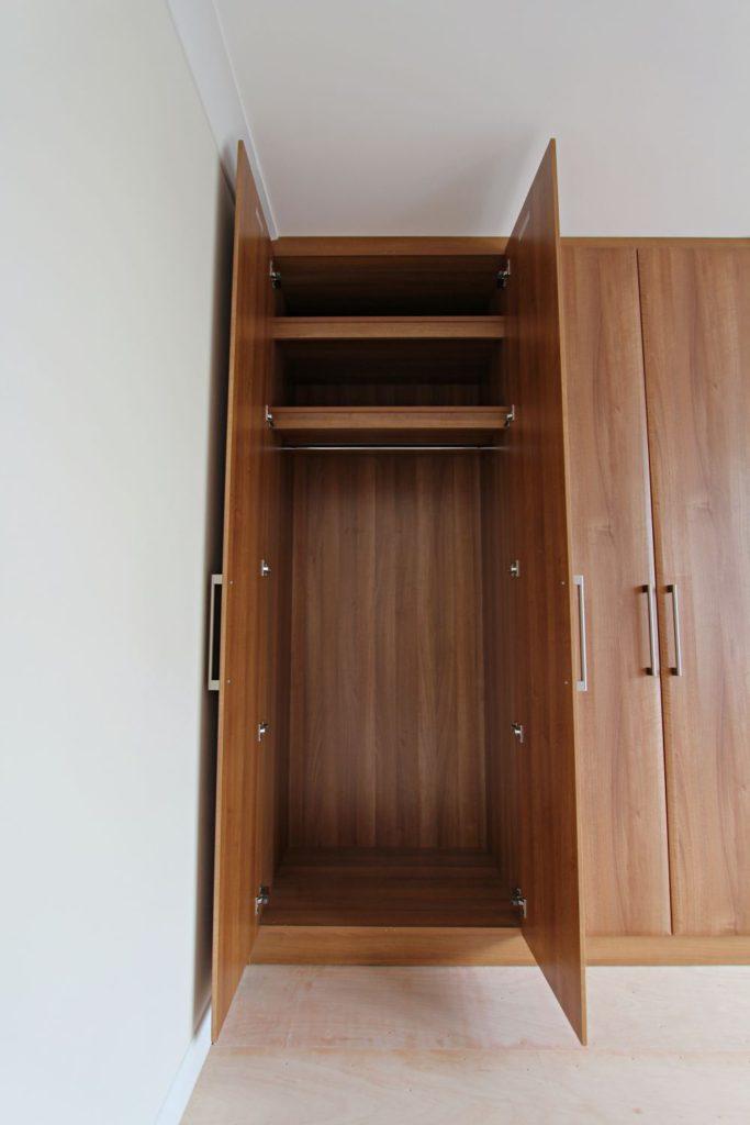 Walnut wardrobe interior hanging space, Winchmore Hill, N21