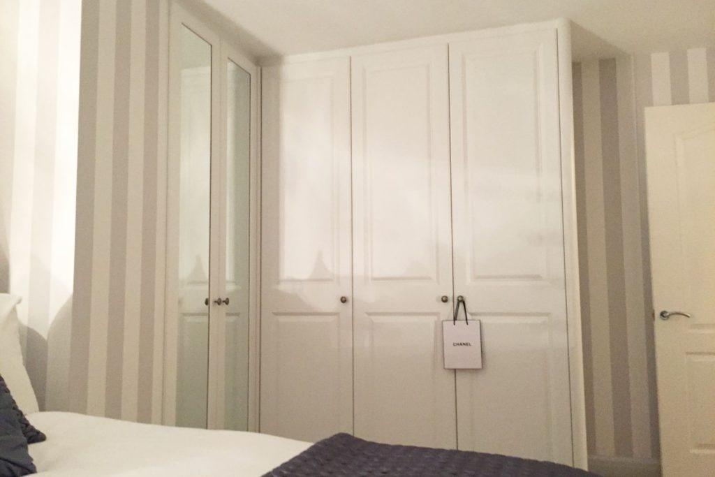 White L shaped wardrobe with finished decor, Hertfordshire